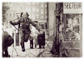 berlinEast-German-border-guard-Conrad-Schumann-leaps-into-the-French-Sector-of-West-Berlin-over-barbed-wire-on-August-15-1961-by-Peter-Leibing1
