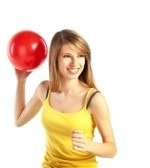 6675630-pretty-smiling-young-blond-woman-in-sportive-cloths-holding-red-ball