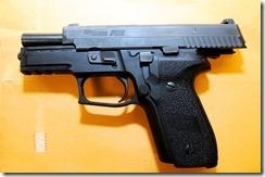 Ferguson-PO-Darren-Wilson-service-pistol-Sig-229