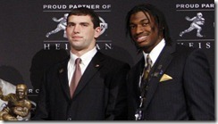 Dec 10, 2011; New York, NY, USA; Heisman Trophy finalists from left Trent Richardson , Montee Ball , Tyrann Mathieu , Andrew Luck , and Robert Griffin III pose for a photo with the Heisman Trophy during a press conference before the announcement of the 2011 Heisman Trophy winner at the Marriott Marquis in downtown New York City.  Mandatory Credit: Jerry Lai-US PRESSWIRE