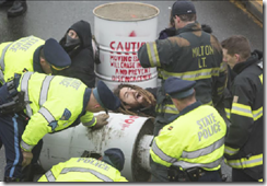 Boston-Protester-Block-Route-93-on-ground-620x429