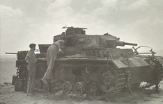 RSG_officers_inspect_destroyed_German_tank_(WWII).jpg