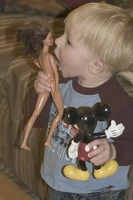 little-boy-kissing-barbie-dolls-breasts1.jpg